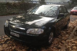 1999 Mazda 323 Protege Sedan 1 6L 4CYL Rego Very Tidy CAR Bargain in NSW