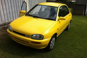 Mazda 121 1991 4D Sedan Manual AIR Steer Books 156 000km in QLD Photo