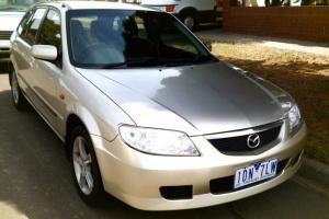 Mazda 323 Astina Shades 2003 5D Hatchback Manual 1 8L Multi Point F INJ in VIC