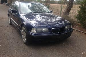 BMW 318i 1998 4D Sedan Automatic 1 8L Electronic F INJ Seats Blue in VIC