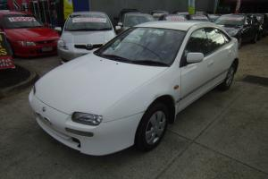 Mazda 323 Astina 1997 5D Hatchback Automatic 1 8L Multi Point F INJ Seats in VIC