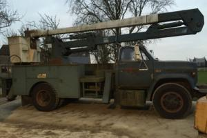 GMC 7000 Truck with 40' cherrypicker and winch ex USAF american Photo