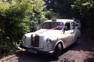 White Classic Carbodies Taxi M Reg / 1995