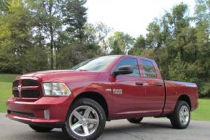 "2015 Ram 1500 4WD Quad Cab 140.5"" Sport Photo"