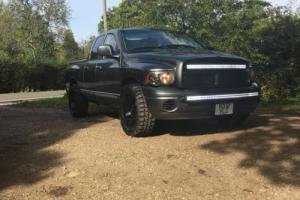american dodge ram 1500 gunmetal grey off road 4x4 style pick up truck