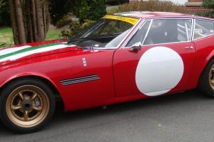 Ghibli Racing Car or rally Ferrari Red Race car