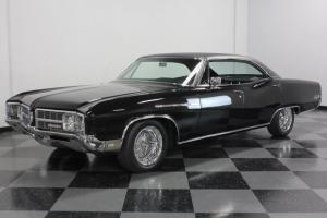 EXCELLENT PAINT, LOTS OF AFTERMARKET STEREO EQUIP, COLD A/C, CLEAN BUICK