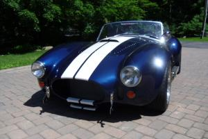1965 Shelby Cobra with a 427 engine coupled to a 5 speed transmission