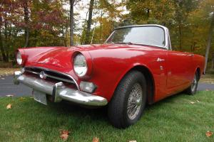1967 Sunbeam Alpine Red with black interior. Wire wheels. Good driving example