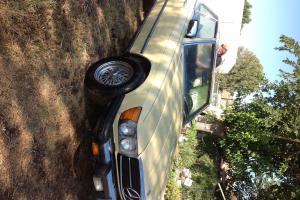 Mercedes 1977 450SL 2 door  convertible Pale Yellow w/ black interior