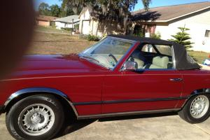 1978 Mercedes 450 SL Convertible Roadster / jump seat. Euro lights, maroon.