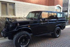 TOYOTA FJ LAND CRUISER 55 LWB CHEVY V8 AUTO RESTORED PS PB CD RHINO BAR BLACK 40