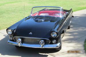 Black with Red and White interior V-8, very original.