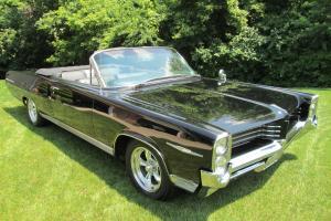 1964 Pontiac Bonneville triple black convertible with American Racing Wheels