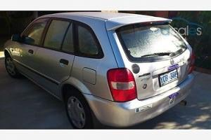 Mazda 323 Astina Shades 2002 5D Hatchback 5 SP Manual 1 6L Multi Point in Kaleen, ACT