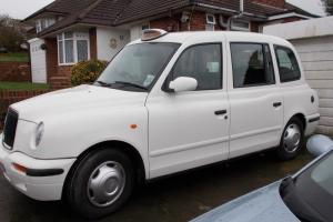 London taxi silverTX11 2002 auto in original white