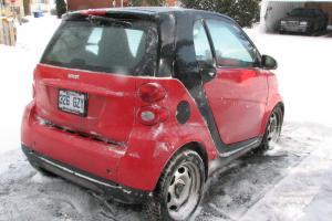 Smart 2009 Passion, Rouge et noir, Équipée pour être remorquée par un motorisé.