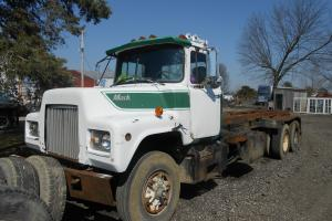 1985 MACK ROLL OFF DM 690S FACTORY12IN. DOUBLE FRAME 199K MILES RUNSNDRIVES NICE