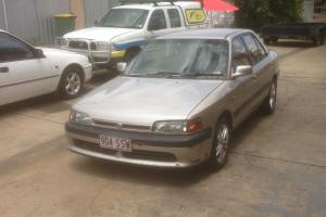 Mazda 323 1993 4D Sedan 4 SP Automatic 1 8L Multi Point F INJ Photo