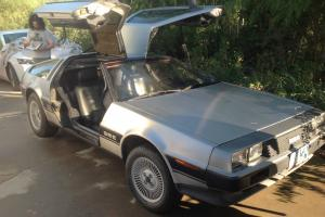 "Sports car, stainless steel, one of a kind ""new"" 1983 Delorean"