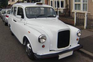 White fairway driver London Taxi