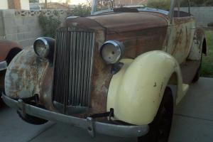 1937 Packard 115c Convertible Rumble Seat.