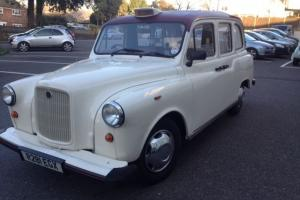 London Wedding Taxi. Roll Top Convertible. White, Fairway. Nissan Engine. Auto.