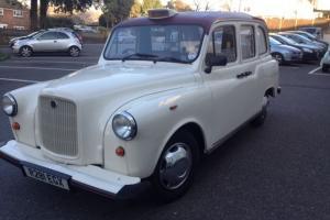 London Wedding Taxi. Roll Top Convertible. White, Fairway. Nissan Engine. Auto. Photo
