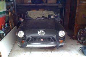 1972 MGB Convertible. Custom top with glass rear window. Extras Included Photo