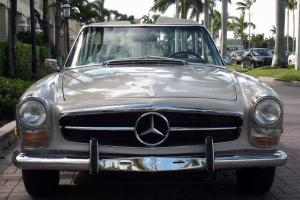 1969 MERCEDES 280 SL. BEIGE WITH BROWN LEATHER. AC. TWO TOPS. EXCELLENT CAR.