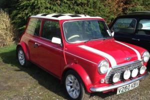 ROVER MINI COOPER 1999. WITH 12MTHS MOT. IN RED/WHITE.