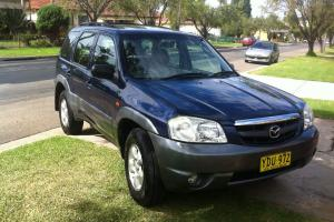 Mazda Tribute Limited 2002 4D Wagon 4 SP Automatic 4x4 3L Multi Point