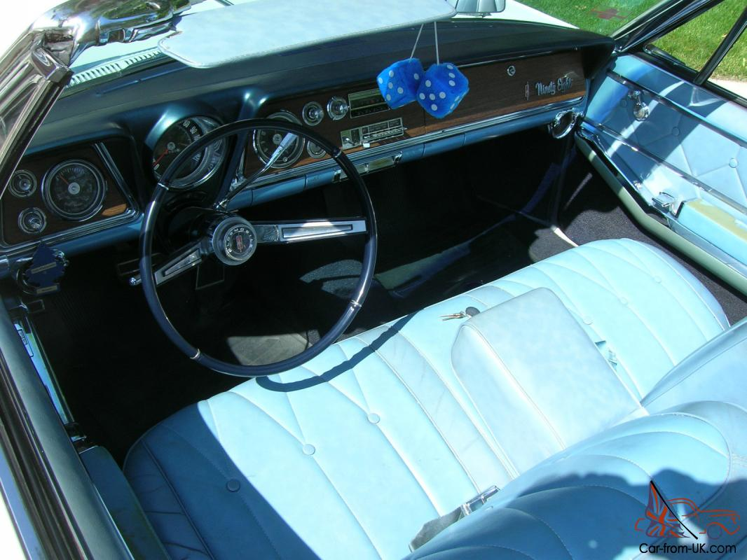1965 Oldsmobile 98 convertible white with white top 78,500 2 owner miles
